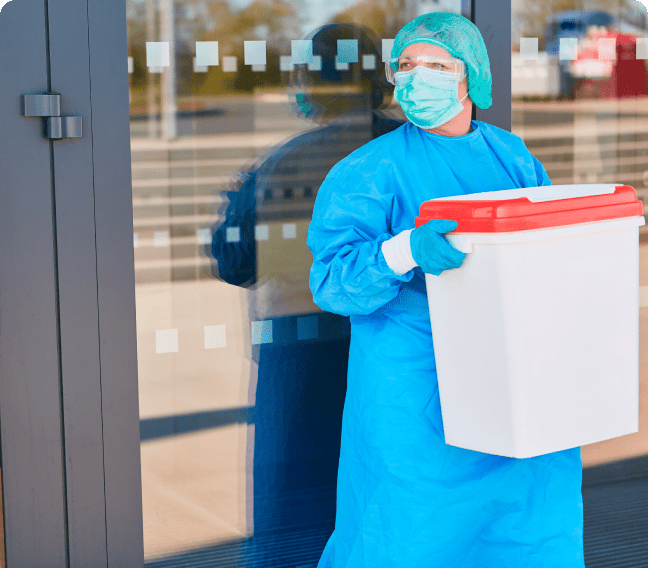 physician holding organ for transplant in cooler
